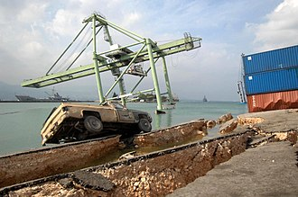 Seattle Fault - Shipping-container crane at Port-au-Prince (Haiti) harbor leaning after earthquake-induced ground failure. Seattle's waterfront faces similar risk