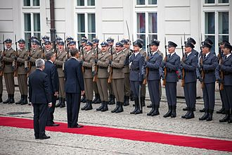 State Partnership Program - Image: President Barack Obama and President Bronislaw Komorowski review troops