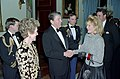 President Ronald Reagan shakes hands with Angie Dickinson.jpg
