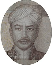 A man in a turban, looking forward