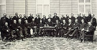 John A. Macdonald - The Quebec Conference. Macdonald seated, fourth from left