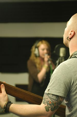 Shot of singer and bassist in recording studio
