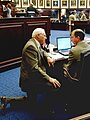 Rep. Ralph Poppell, R-Titusville, left, and Rep. Carey Baker, R-Eustis, right, confer on the House floor March 9, 2004.jpg