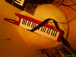 MIDI controller - A Roland keytar, a keyboard MIDI controller designed to be worn with a shoulder strap during performance. The keytar does not produce any musical sounds by itself. As a MIDI controller, it only sends data about which keys or buttons are pressed to a MIDI-compatible sound module or synthesizer, which then produces the sounds.