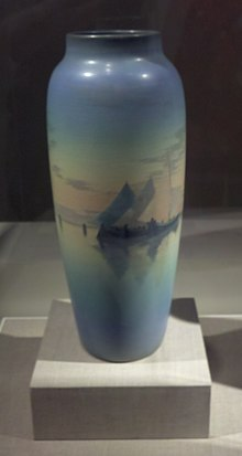 Photo of a tall blue Rookwood vase made by Carl (Charles) Schmidt ca. 1904, on display at the De Young Museum in San Francisco