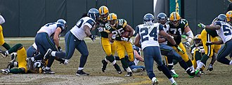 2009 Green Bay Packers season - Ryan Grant running through the line for a 56-yard touchdown against Seattle.