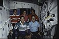 S43-40-017 - STS-043 - STS-43 crewmembers pose for inflight portrait on OV-104's middeck - DPLA - 9338774ad56c0f5fd4ee63aa5084e66c.jpg