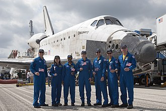 Alan G. Poindexter - The crew of STS-131 pose in front of the Shuttle orbiter after the mission. Commander Poindexter first from the right side.