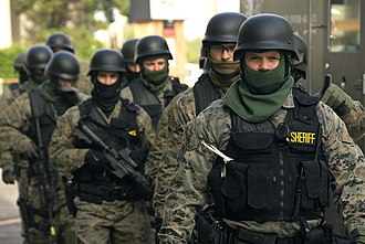 Paramilitary - An Oregon Sheriff's Department SWAT team in full tactical gear.