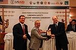 Saghir Ahmed receives an award from Michael Curtis (13263870044).jpg