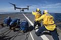 Sailors signal an MV-22 Osprey 150111-N-DQ840-121.jpg
