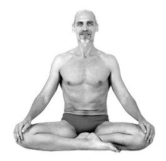 Siddhasana - An easier variant with the feet on the ground, sometimes called Muktasana, also used for meditation
