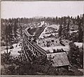 Secret Town Trestle on the Central Pacific Railroad's grade, well west of Donner Summit, circa 1870 (with train).jpg