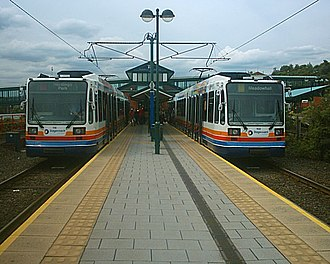 Sheffield Supertram - Two Siemens-Duewag Supertrams at Meadowhall Interchange in July 2004 in a modified version of the original Stagecoach livery