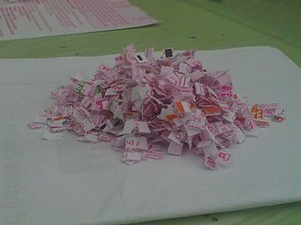 Paper shredder - The shredded remains of a National Lottery play slip.