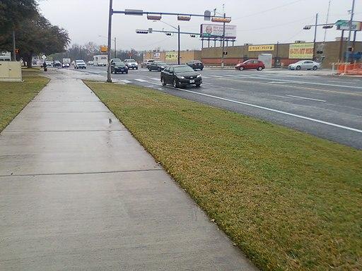 Sidewalk and road after rain