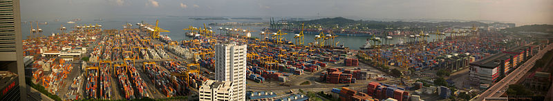 The Port with a large number of shipping containers and the ocean visible in the background