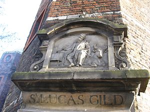 Arti et Amicitiae - Gable stone of the old Sint Lucas guild above the door of its former location, Waag, Amsterdam.