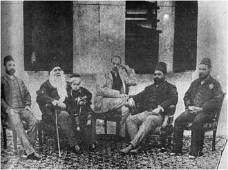 Syed Ahmad Khan - Sir Syed with his son Syed Mahmood, grand son Syed Ross Masood, and some admirers.