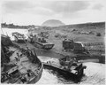 Smashed by Japanese mortar and shellfire, trapped by Iwo's treacherous black-ash sands, amtracs and other vehicles of... - NARA - 513222.tif