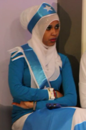 Flag of Somalia - Somali woman wearing a Somali flag dress.