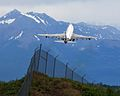 Southern Air 747 clearing the fences and missing the mountains (6311110276).jpg