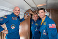Soyuz TMA-13M crew aboard a Russian Federal Space Agency aircraft.jpg