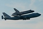 Space Shuttle Endeavour and carrier plane flying over San Francisco Bay - profile view.jpg