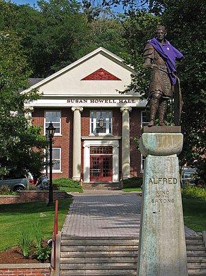 Alfred University - The statue of King Alfred stands at the center of AU's quad, and is often decorated by students. In this picture, he is wearing one of the purple shirts worn by student Orientation Guides (OGs) during the 2006 freshman orientation.