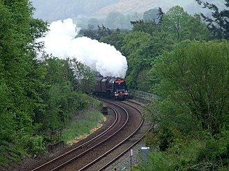 Llandygai - Steam train taking the bend prior to entering the tunnel at Llandegai