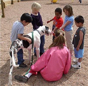 Animal-assisted therapy - Pets may promote kindness in children.