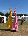 Stilt people (18844685103).jpg