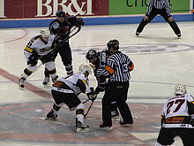 Gregg Johnson faces off against Barret Ehgoetz; Cincinnati Cyclones at South Carolina Stingrays, March 7, 2010.