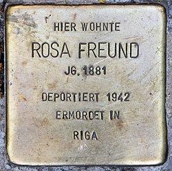 Photo of Rosa Freund brass plaque