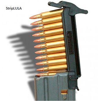 Stripper clip - Stripper clip loader for a M16 STANAG detachable magazine.