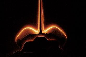 STS-62 - Shuttle glow phenomena lights up the orbiter's tail.