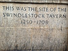 "Plaque that reads ""This was the site of Swindlestock Tavern 1250–1709"""