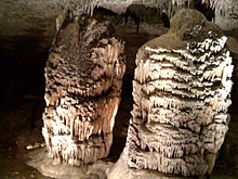 "These two large stalagmites were named ""The Hall of Giants"" by the first explorers, a group of twelve women, who discovered them in 1867 at Fantastic Caverns."