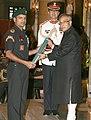 The President, Shri Pranab Mukherjee presenting the Ati Vishisht Seva Medal to Subedar Major Vijay Kumar, at the Defence Investiture Ceremony – II, at Rashtrapati Bhavan, in New Delhi on April 27, 2013.jpg