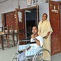 The physically handicapped voter showing mark of indelible ink after casting his vote, at a polling booth, during the 5th Phase of General Elections-2014, at Siliguri, Darjeeling on April 17, 2014.jpg