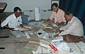 The polling officials checking Electronic Voting Machine (EVM) and other necessary belongings for use in the second phase of General Elections-2009 at Kala Parishad Bhawan Vanganga, Bhopal on April 22, 2009.jpg