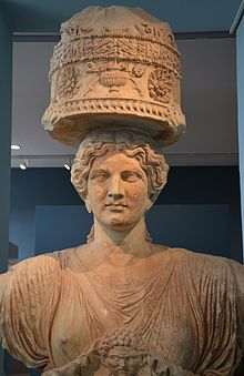 The upper part of one of the caryatids that flanked the Lesser Propylaea of Eleusis, made in Attica in about 50 BC, Eleusis Museum (16172984501).jpg