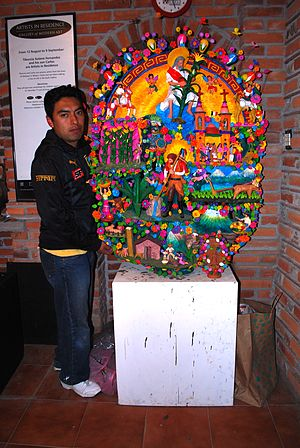Soteno family - Carlos Soteno with one of his creations at the family workshop