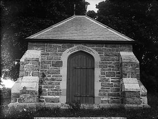 Tomb of R J Ll Price, Rhiwlas in Llanfor churchyard, 1887