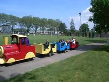 File:Trackless kiddie train Manorhaven Pk 2011-05-30 1422 jeh.ogv