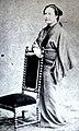 Tsuru-Glover-wife-standing.jpg