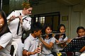 U.S. 7th Fleet Band works with music students. (8548985180).jpg