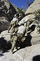 U.S. Airmen assigned to the 48th Rescue Squadron navigate a cliff while moving a simulated patient up the rugged terrain during high angle, rope rescue training at Mount Lemmon near Tucson, Ariz., Feb. 12 140212-F-WQ860-087.jpg