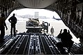 U.S. Airmen assigned to the Alaska Air National Guard load a luggage pallet onto a C-17 Globemaster III aircraft at Joint Base Elmendorf-Richardson, April 9, 2012, before flying to Nome, Alaska, to participate 120409-F-ZH346-003.jpg
