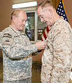U.S. Army Gen. Martin E. Dempsey, left, the chairman of the Joint Chiefs of Staff, presents a Defense Distinguished Service Medal to U.S. Marine Corps Gen. Joseph F. Dunford Jr., the outgoing commander of 140826-D-HU462-360.jpg